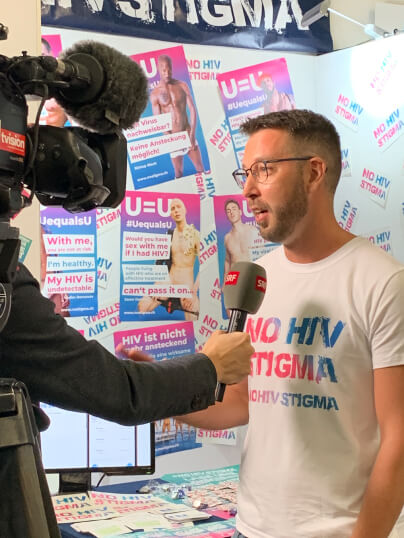Alex Schneider is interviewed about the NoHIVstigma campaign by the local TV channel SRF for the evening news - Tagesschau.
