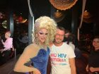 In the bar Rouge, Drag Queen Priscilla, Queen of Mykonos, urges to guests to participate in the NoHIVstigma campaign to dispel the fear of HIV.